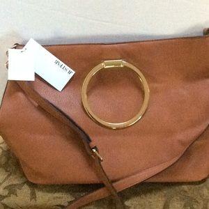 Just fab tan poly vinyl purse.  Large. New